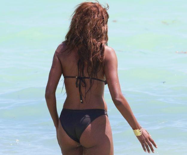 Claudia Jordan in a brown sequin bikini at the beach in Miami