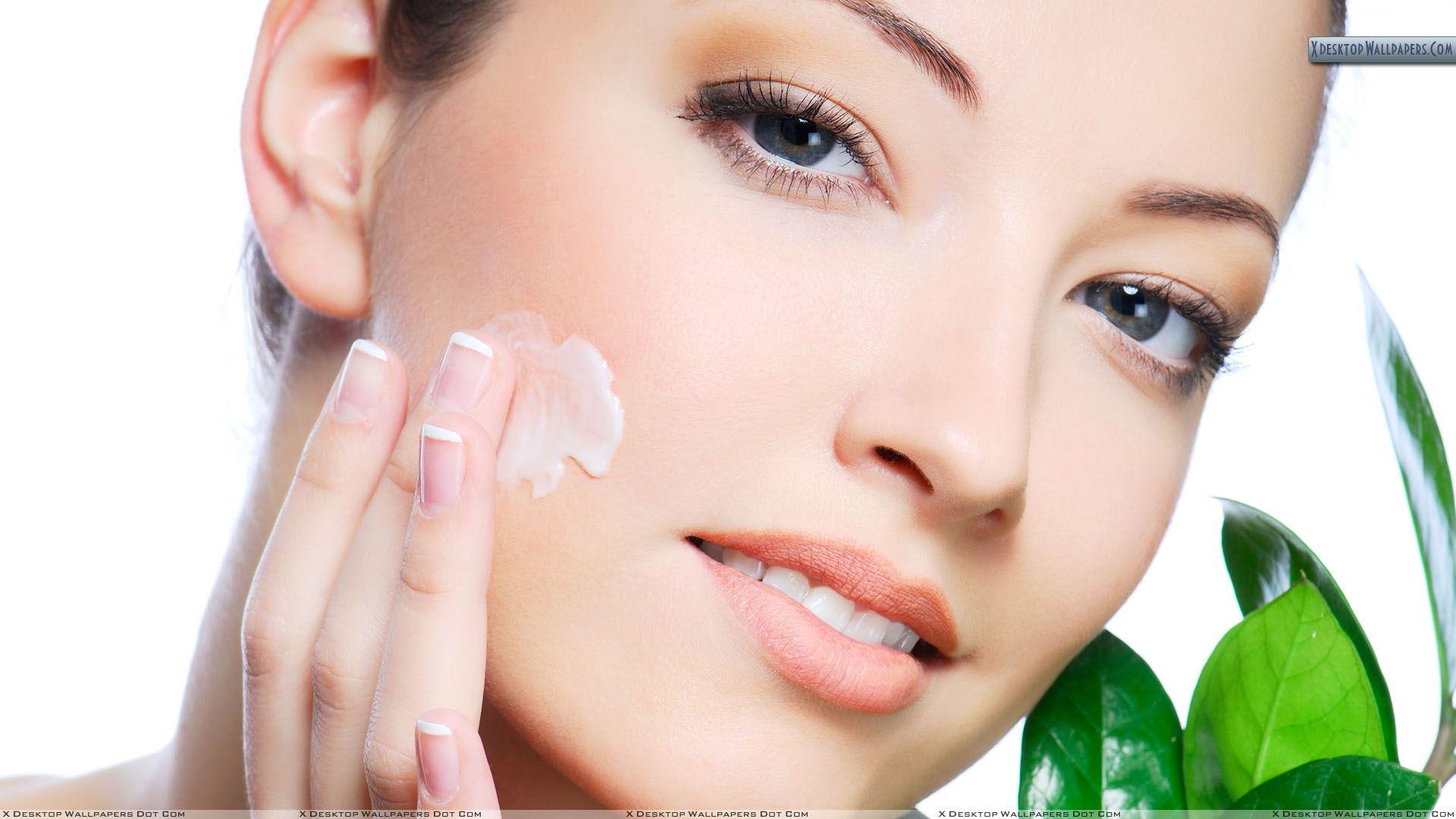 female-model-applying-cream-on-her-face-218930
